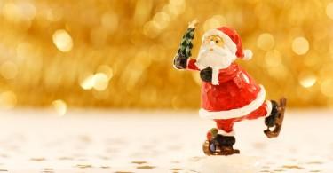 figurine-of-santa-claus-holding-xmas-tree