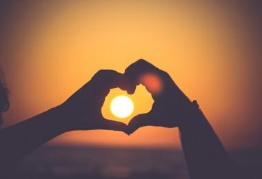 sunset-seen-through-hands-in-heart-shape